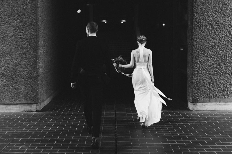 bride and groom in the barbican in london by contemporary destination wedding photographer Miss Gen