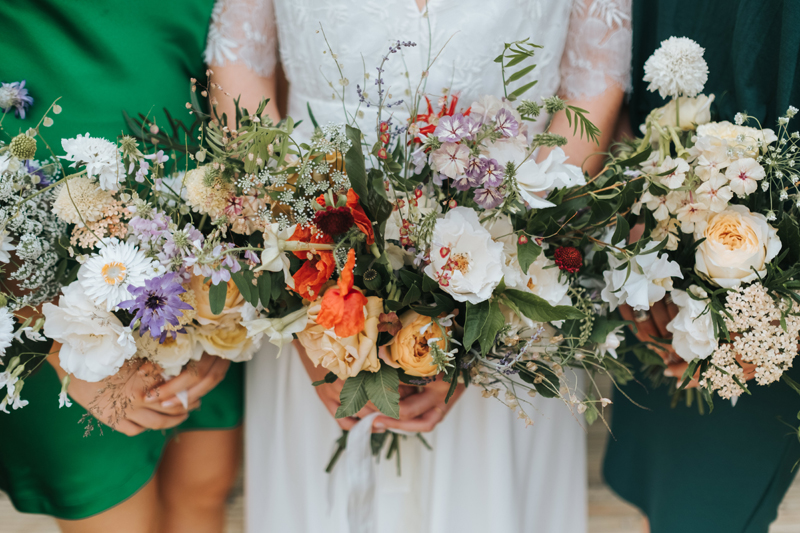 close up of summer wedding bouquets by miss gen