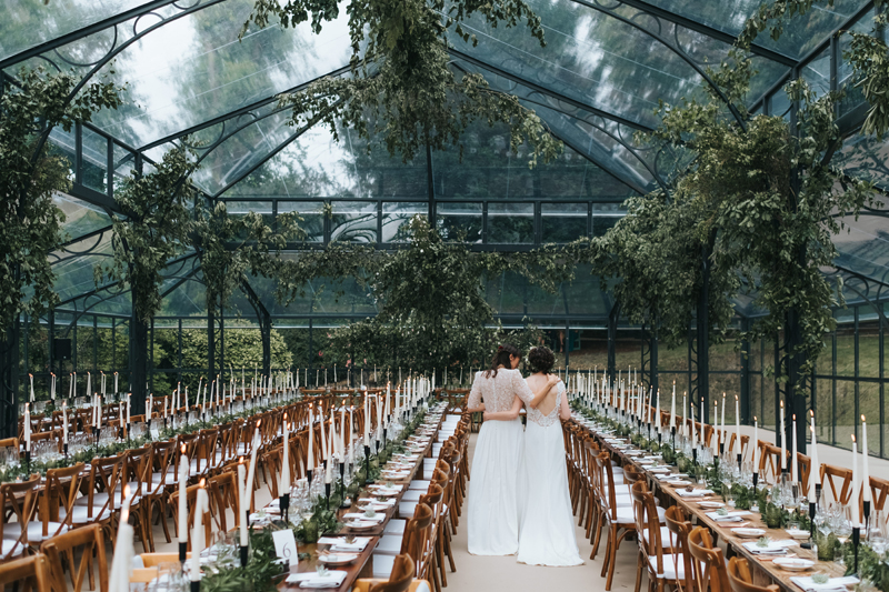 brides in beautiful glass wedding marquee by london wedding photographer miss gen