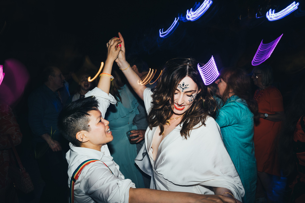 two brides dancing at their gay wedding by london photographer miss gen