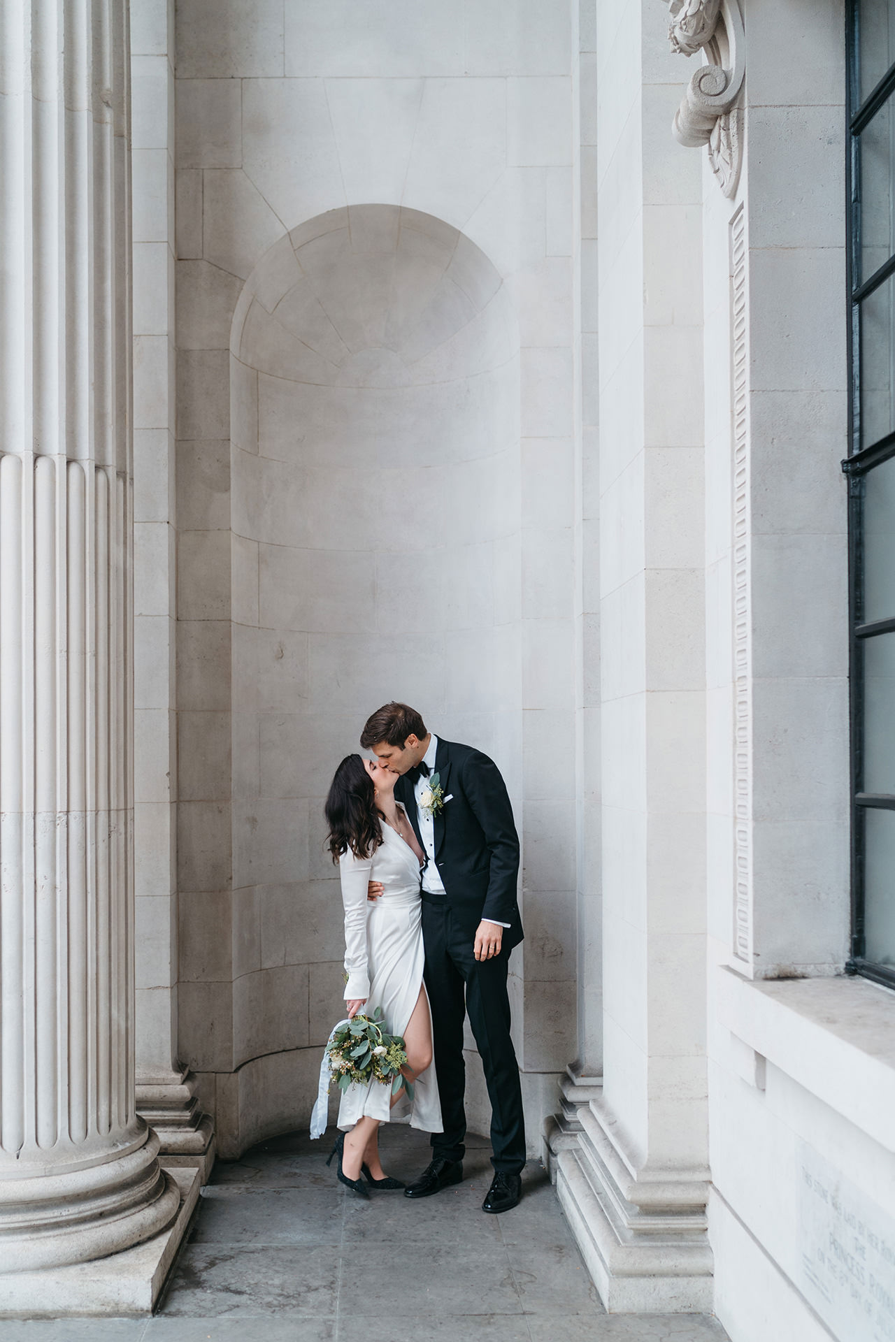 Couple kissing on the steps of Marylebone Town Hall in London after their Elopement
